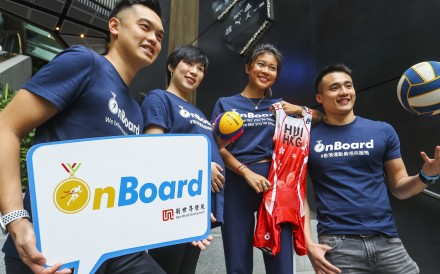 OnBoard co-founders Garrick Lau (left) and Gary Fung (right), flank two beneficiaries of the scheme Joanne Shum and Vincci Hui. Photo: Edmond So
