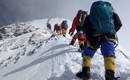 Queues form on Everest as there is a rush for the peak when the weather window opens. Too many permits and not enough experience produce fatal traffic jams. Photo: Gesman Tamang