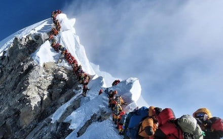 A traffic jam of climbers block the route to and from the summit of Everest, possibly killing Anjali Kulkarni after she spent too long at high altitude. Photo: Project possible
