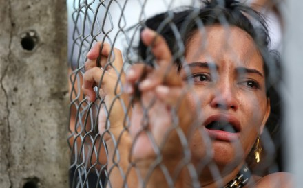 A relative of an inmate reacts in front of a prison complex in the Brazilian state of Amazonas after prisoners were found strangled to death in four separate jails, according to the penitentiary department in Manaus, Brazil May 27, 2019. REUTERS/Bruno Kelly