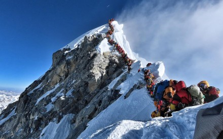 This startling photograph of a human traffic jam that stranded climbers for hours on a ridge below the summit of Mt Everest illustrate a disaster waiting to happen. Photo: AFP Photo / Project Possible