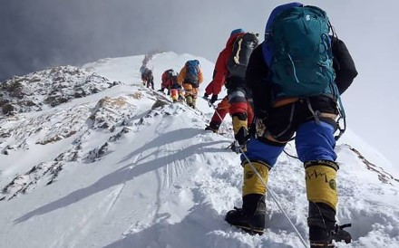 Climbers join the line en route to the summit. Photo: AFP