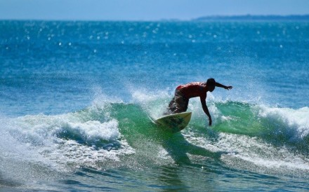The waves around the resort and beach area of Kuta, one of the Indonesian island of Bali's earliest tourist developments, are ideal for surfers of all abilities. Photo: Wikimedia