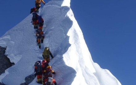 The three Hong Kong climbers with another group on the South Summit of Everest. Photo: Hong Kong Mountaineering and Climbing Union