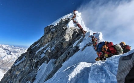 Climbers line up for hours to reach the summit of Mount Everest on May 22. Photo: @nimsdai Project Possible via AFP