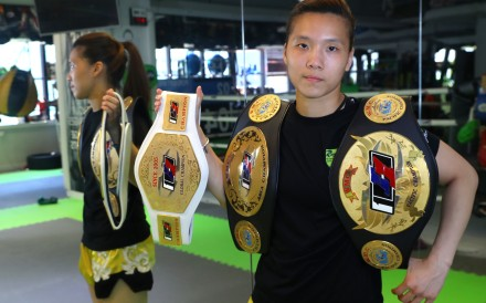 Kwok Hoi-ling shows off her championship belts during a break from training in Mong Kok this month. Photo: Edmond So