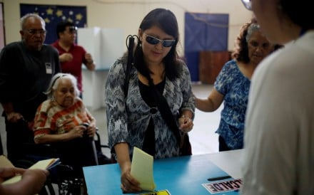A blind woman votes during the general elections in Guatemala City on Sunday. Photo: EPA-EFE