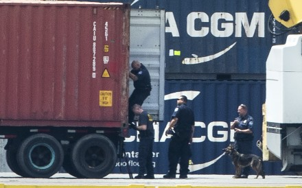 Authorities search a container along the Delaware River in Philadelphia on Tuesday. Photo: AP