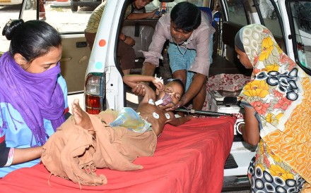 An Indian child suspected to have Acute Encephalitis Syndrome (AES) arrives at the government-run Sri Krishna Medical College and Hospital in the eastern state of Bihar. Photo: AFP