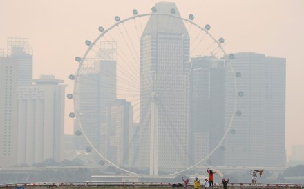 The Singapore Flyer observatory wheel is shrouded by haze. Photo: Reuters