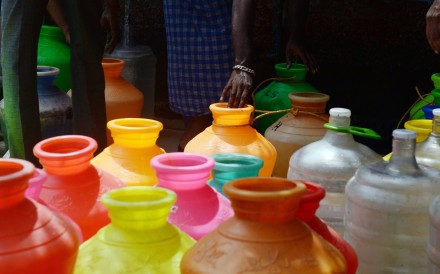 Plastic pots filled with drinking water at a distribution point in Chennai. Photo: AFP