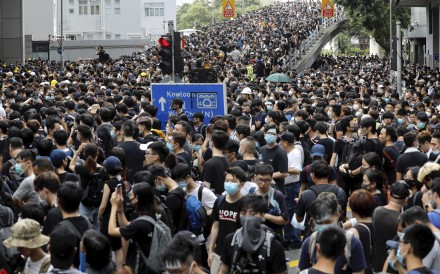 Protesters gather near the police headquarters in Hong Kong on June 21. Photo: AP