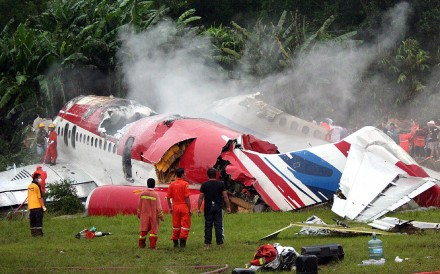 Rescue workers stand next to the wreckage of Thai budget carrier One-To-Go plane in September 2007. Photo: AFP