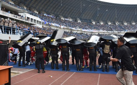 Indonesia riot police stand guard during a match between Persija and Bandung, before which a Persija fan Haringga Sirla was beaten to death. Photo: AFP