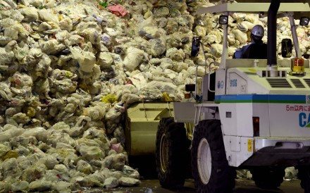 A loader moves plastic recyclable resources onto a conveyor belt at Ichikawa Kankyo Engineering recycle centre in Narashino. Photo: AFP