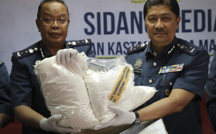 Customs officials display seized drugs in Sepang. Malaysia's government has announced plans to remove criminal penalties for the possession and use of drugs in small quantities. Photo: AP