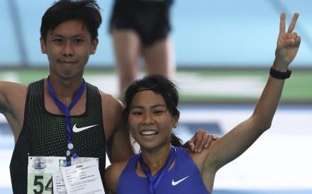 Christy Yiu Kit-ching with husband Chan Ka-ho after winning the women's half marathon at the Standard Chartered Hong Kong Marathon in February. Photo: Nora Tam