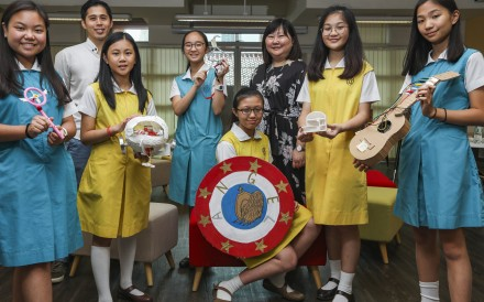 Department head Shirley Ann Fu (third right), teacher Thomas Lee and Secondary Two pupils, including Venice Hung (second right), show off the projects. Photo: Xiaomei Chen