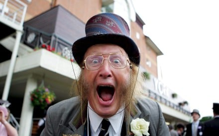 John McCririck poses for the camera at the first day of the Royal Ascot meeting in York, Britain, 14 June 2005. Photo: EPA-EFE