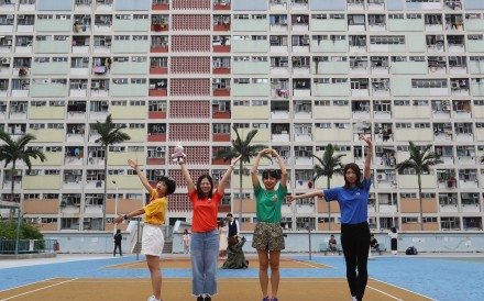 Tourists pose for photos at Choi Hung Estate, which has become an unlikely tourist attraction in Hong Kong. Photo: Edmond So