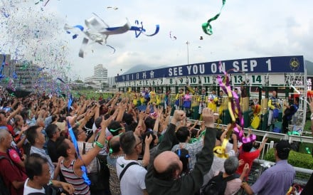 Jockeys throw toys to the fans after the season finale at Sha Tin on Sunday. Photos: Kenneth Chan