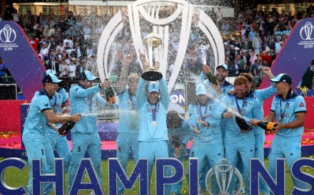 England players celebrate at Lord's Cricket Ground. Photo: dpa