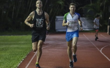 SCMP reporter Patrick Blennerhassett (left) works out with one of Hong Kong's top trail runners Jeff Campbell in Cheung Sha Wan. Photo: Jonathan Wong