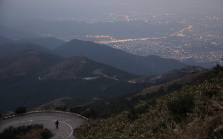 A hiker climbs Tai Mo Shan early in the morning. The long winding road is a good place for hill running training, but not advisable for beginnings. Sam Tsang
