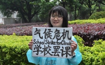 Howey Ou (not her real name) stages a protest outside the Guilin People's Government building in southern China.