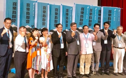 Members of the new Formosa Alliance celebrate after electing chairman Terence Lo (fifth from right) and executive committee members on Saturday. Photo: Lawrence Chung