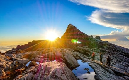Sunrise above the rocky terrain of Malaysian Borneo's Mount Kinabalu on the hike down from Low's Peak. Photo: Nam Cheah