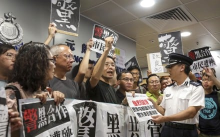 Protesters demonstrate at Yuen Long police station the day after a group of thugs attacked passengers in a train station. Photo: Felix Wong