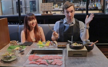 Avowed vegan Lim Li Ying (left) and her meat-eating colleague Douglas Parkes have a meal at the meat grill Yakiniku Jumbo in Central, Hong Kong.