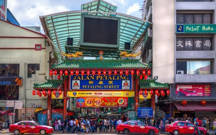 Crowds pass below the main gate of Petaling Street, now home to a slew of trendy cafes, restaurants and bars. Photo: Shutterstock