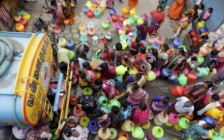 Indians stand in queues to collect drinking water from a tanker in Chennai. Photo: AP