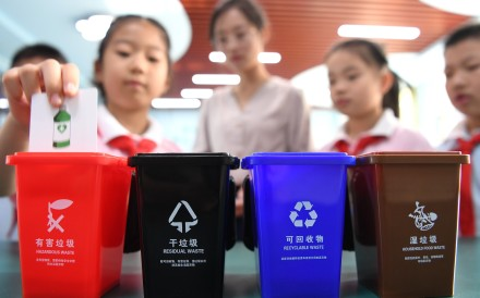 Pupils take part in a waste sorting game as part of an effort to encourage people to separate their rubbish, which had led to a surge in production of plastic bins. Photo: Xinhua