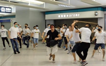 White-clad men attacked travellers and passers-by at Yuen Long station on Sunday night. Photo: Facebook