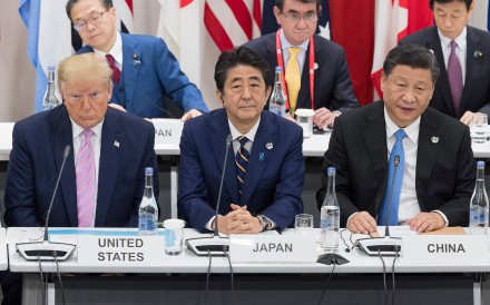 US President Donald Trump (from left) sits with Japanese Prime Minister Shinzo Abe and Chinese President Xi Jinping as they attend a meeting on the digital economy at the G20 Summit in Osaka on June 28. Photo: TNS