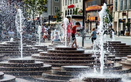People cool off in the fountains at Toldbod Plads in Aalborg, Denmark. Photo: AFP