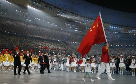 Yao Ming and earthquake survivor Lin Hao lead the opening ceremony of the Beijing 2008 Olympic Games at the National Stadium. Photo: Reuters