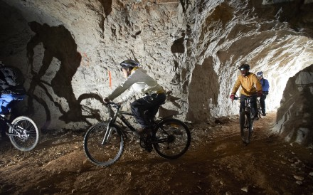 Underground cave biking in Slovenia is a popular adventure.