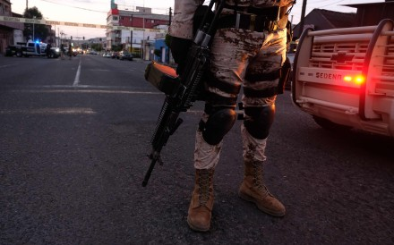 Mexican soldiers guard a crime scene in downtown Tijuana in April 2019. Photo: AFP