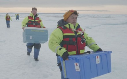 Scientists carry boxes of ice cores drilled from the Canadian Arctic. Photo: Reuters