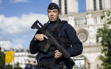 A French police officer stands guard outside the Notre Dame cathedral. File photo: EPA