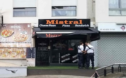 Policemen outside the eatery where a waiter was shot dead by a customer allegedly angry at having to wait for a sandwich, in the eastern Paris suburb of Noisy-le-Grand on Saturday. Photo: AFP