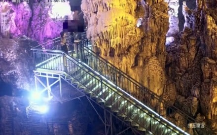 Security cameras caught a tourist at Tai Qing cave in Yuanan, Hubei province, as he snapped a stalactite and passed bits to his friends. Photo: Weibo