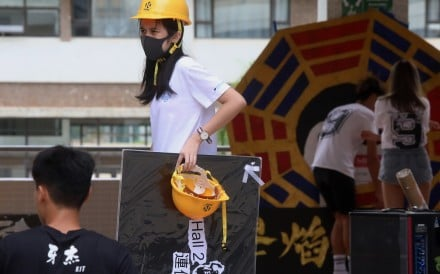 Some students dressed in full protest gear on orientation day at Hang Seng University, Sha Tin on Tuesday. Photo: K.Y. Cheng