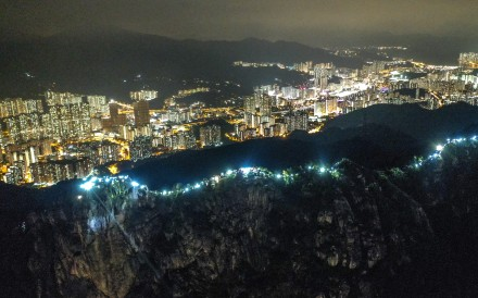 The slopes of Lion Rock were lit up on Friday with flashlights and laser pointers. Photo: Winson Wong
