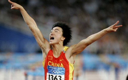 China's Liu Xiang celebrates as he crosses the finish line to win the men's 110m hurdles final at the Athens 2004 Olympic Summer Games. Photo: Reuters