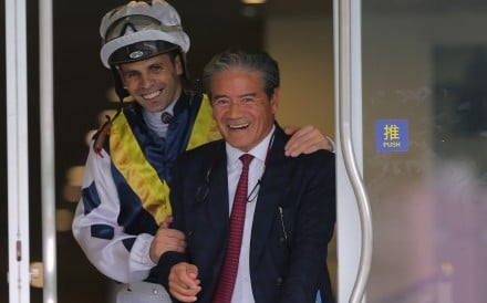 Jockey Aldo Domeyer and trainer Tony Cruz celebrate their win in the stewards room after the run of Sunshine Warrior. Photos: Kenneth Chan